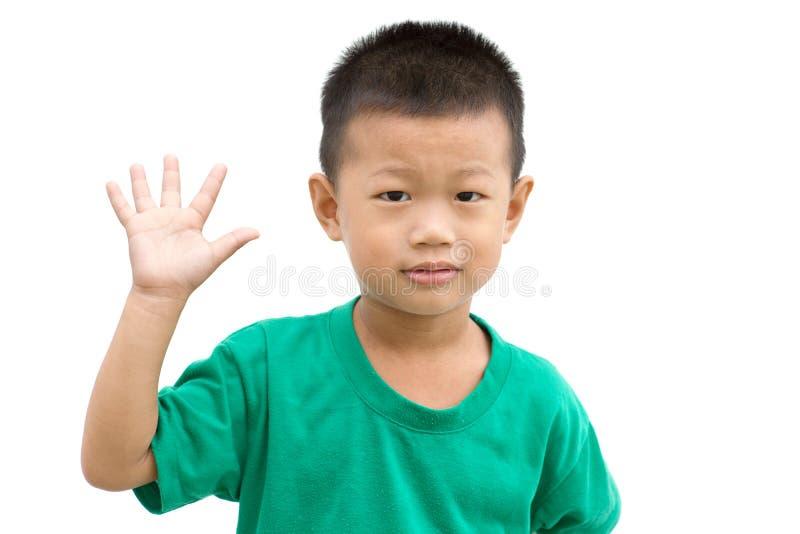显示棕榈的亚裔孩子 库存图片