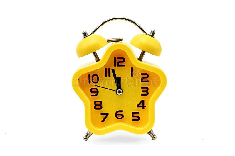 显示残余的时间的星号圣诞节时钟直到在白色背景的半夜12点 黄色 十二o `时钟 库存照片