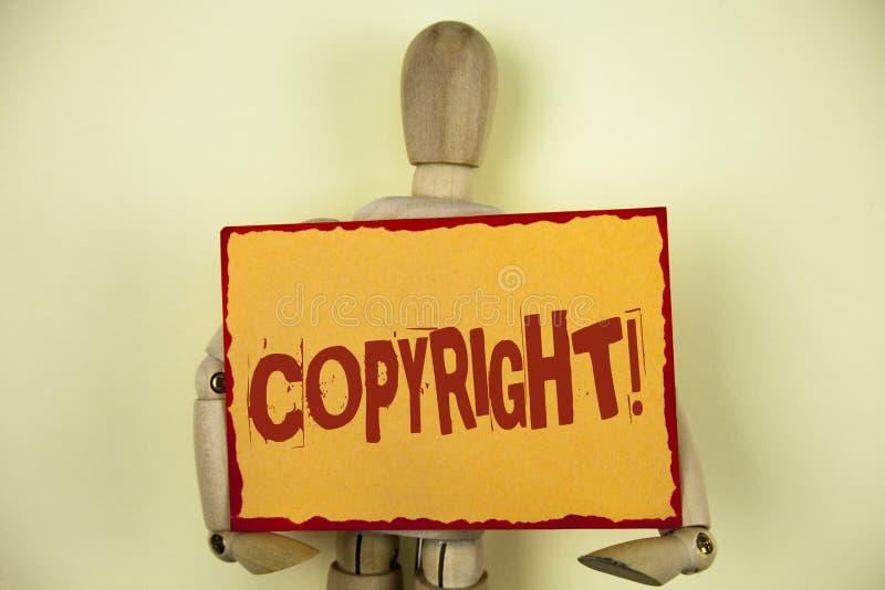 显示版权诱导电话的概念性手文字 企业对照片的文本书面的知识产权海盗行为说不 库存照片