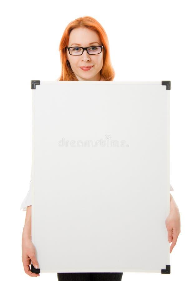 显示牌年轻人的空白女实业家 库存照片