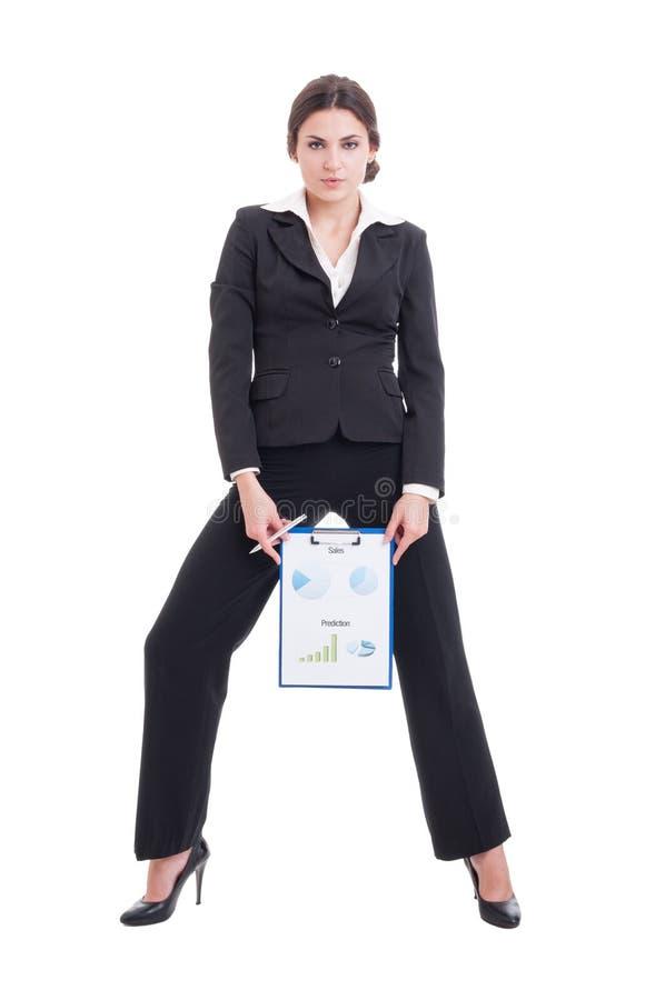 显示生长赢利图的年轻和性感的销售妇女 免版税库存照片