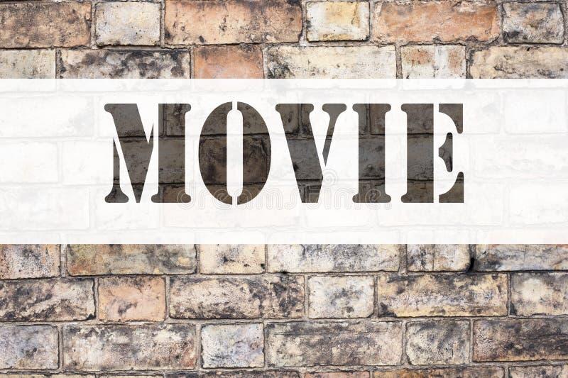 显示电影的概念性公告文本说明启发 娱乐在老砖写的影片的企业概念 库存照片