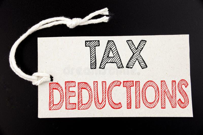 显示税收减免的手写的文本说明 企业在pric写的财务接踵而来的税钱扣除的概念文字 免版税库存图片