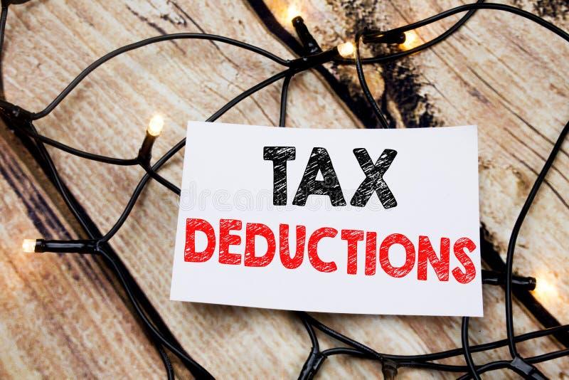 显示税收减免的手写的文本说明 企业在stic写的财务接踵而来的税钱扣除的概念文字 图库摄影