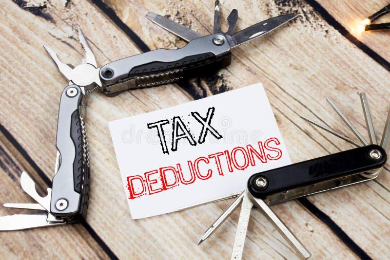 显示税收减免的概念性手文字文本说明启发 财务接踵而来的税钱扣除的企业概念 库存图片