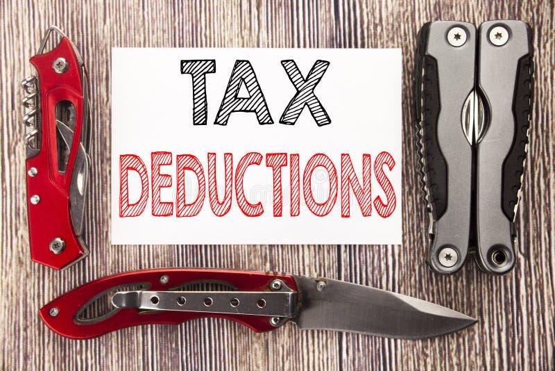 显示税收减免的概念性手文字文本说明启发 财务接踵而来的税钱扣除的企业概念 免版税库存照片