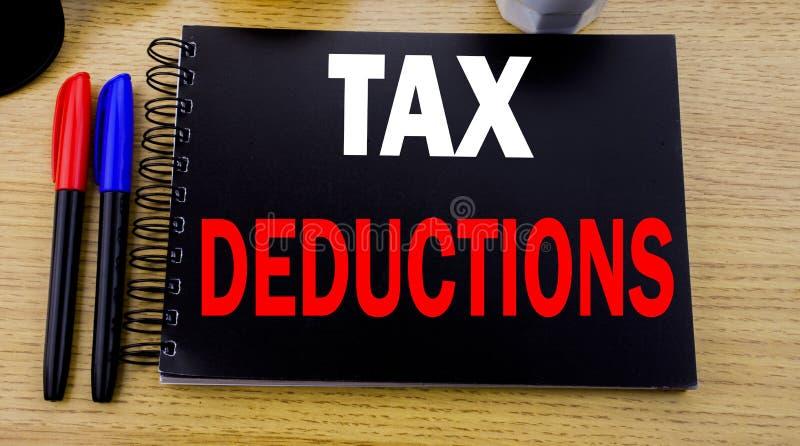显示税收减免的概念性手文字文本说明 书面的财务接踵而来的税钱扣除的企业概念  图库摄影