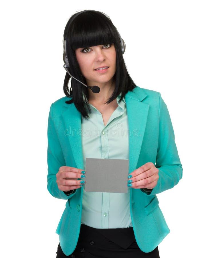 显示空白牌的愉快的微笑的新女商人 库存图片