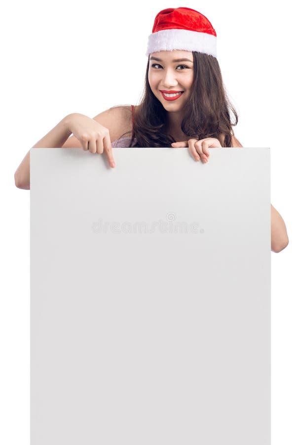 显示空白的广告牌横幅标志的圣诞节年轻亚裔妇女 库存图片