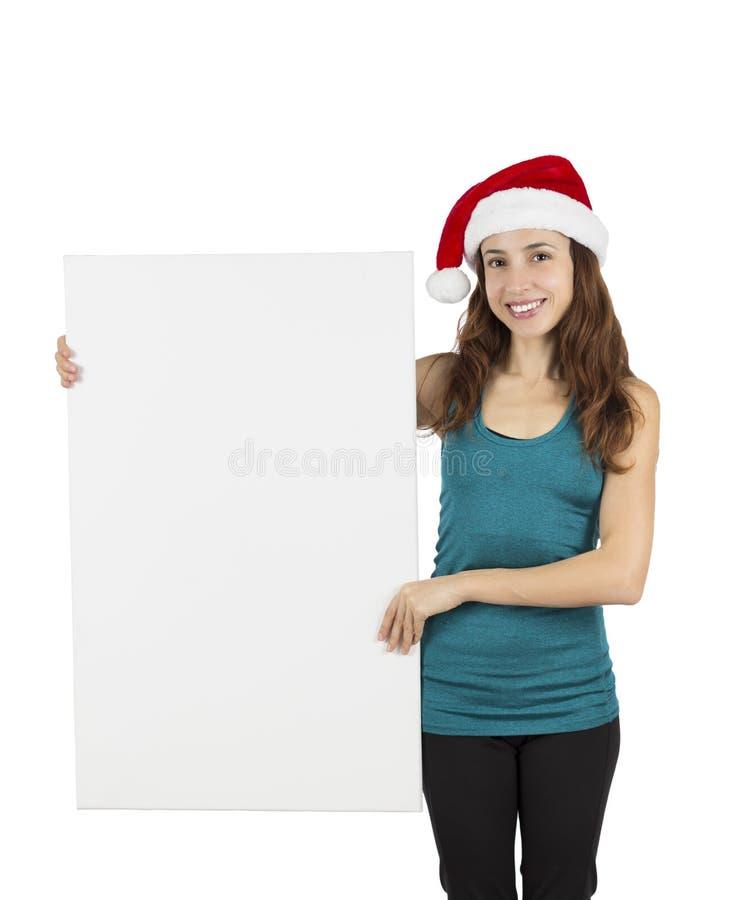 显示空白的海报的圣诞节妇女 库存图片