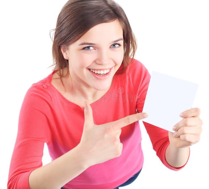 显示空的白纸标志板的妇女 免版税库存照片