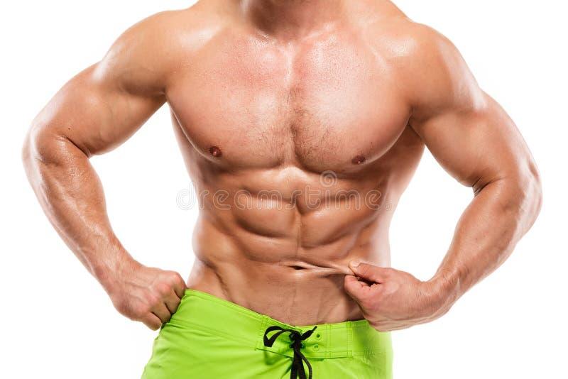 显示腹肌的强的运动人健身模型躯干 免版税库存图片