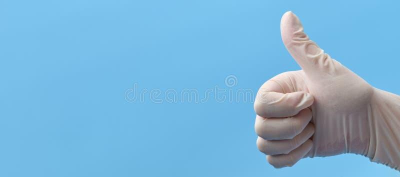 ?? 显示赞许一只手的片段在白色医疗手套的 指向的手  图库摄影