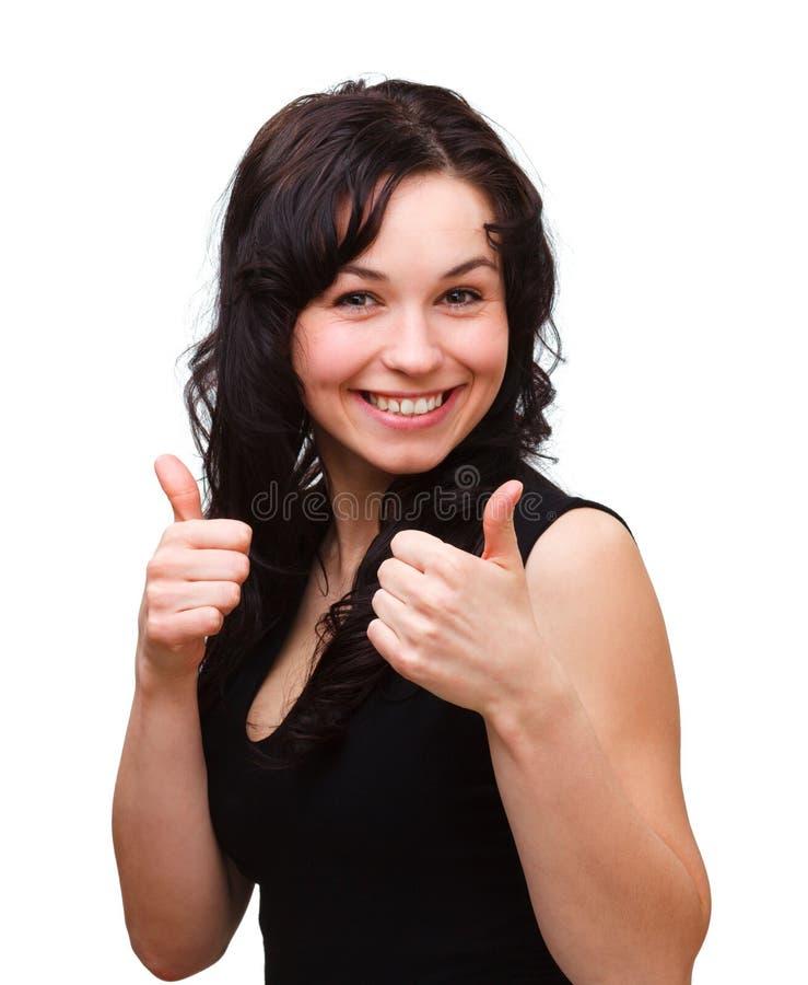显示赞许妇女年轻人的姿态 免版税库存照片