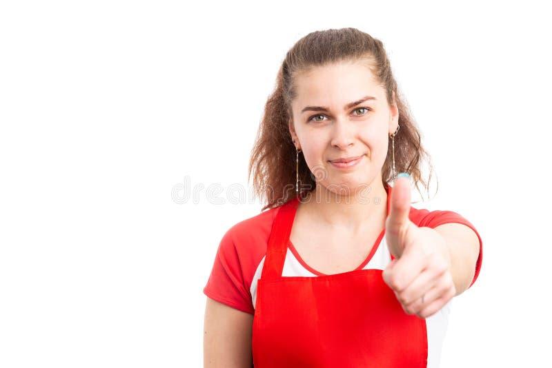 显示赞许的女性超级市场雇员 库存照片