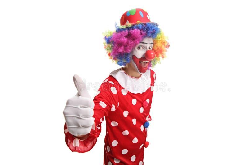 显示赞许的快乐的小丑 库存图片