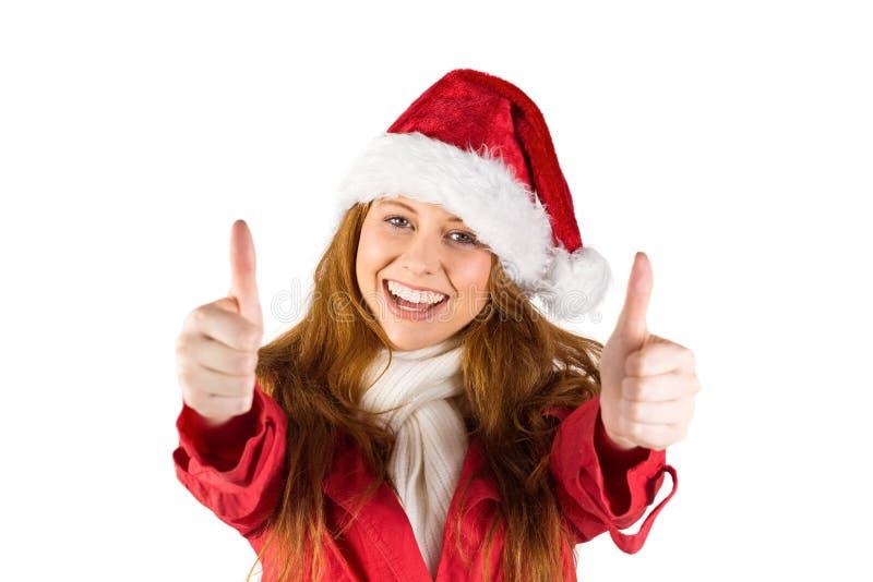显示赞许的欢乐红头发人 免版税库存照片