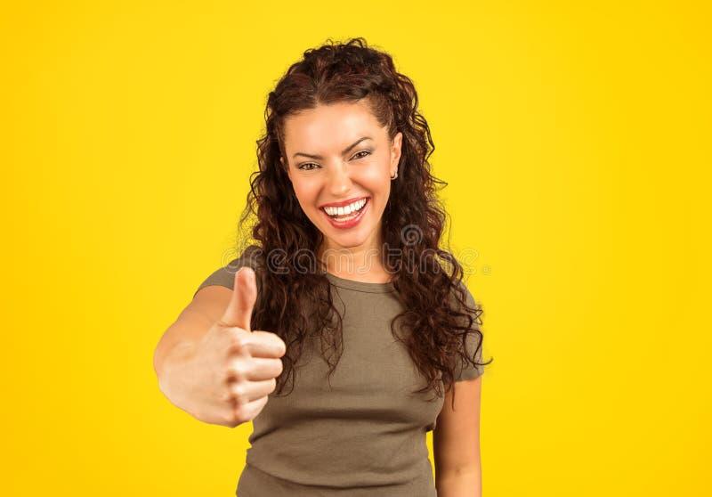 显示赞许的激动的俏丽的妇女 库存照片