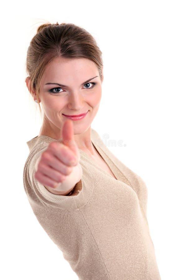 显示赞许符号的美丽的少妇 免版税库存照片