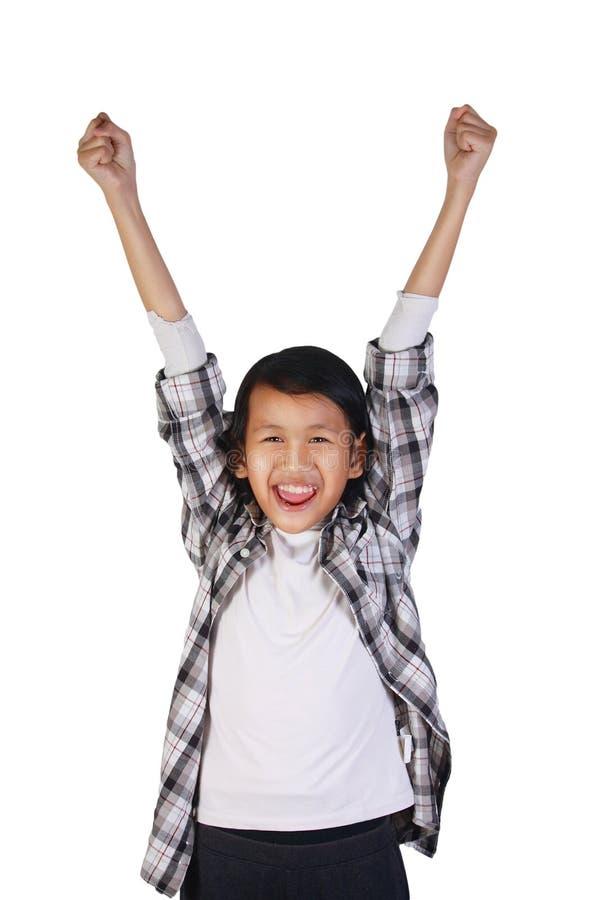 显示赢取的姿态的愉快的亚裔小女孩 库存图片