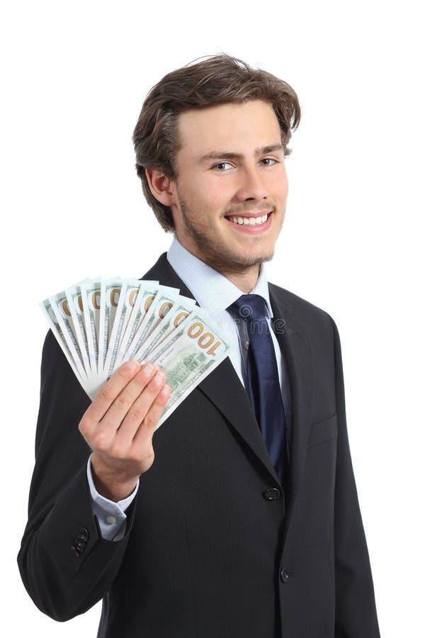 显示金钱的年轻愉快的商人 库存照片