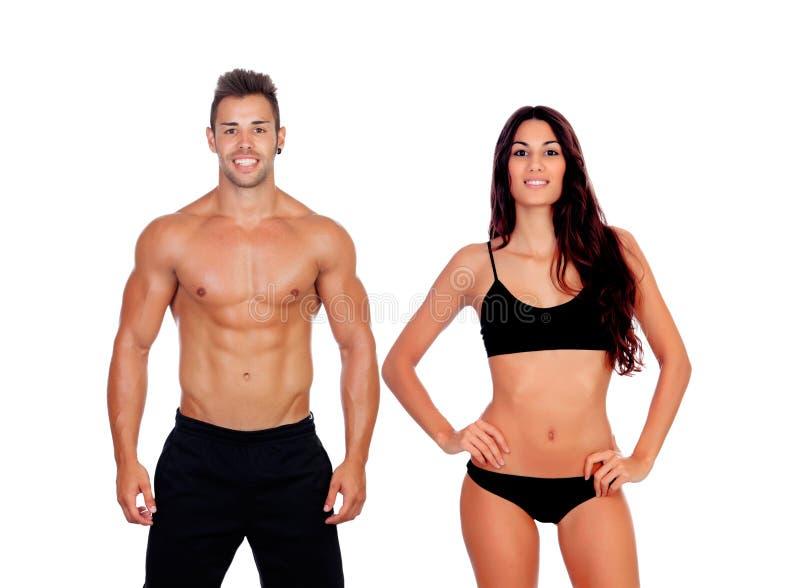 显示他们完善的身体的年轻夫妇 免版税库存照片