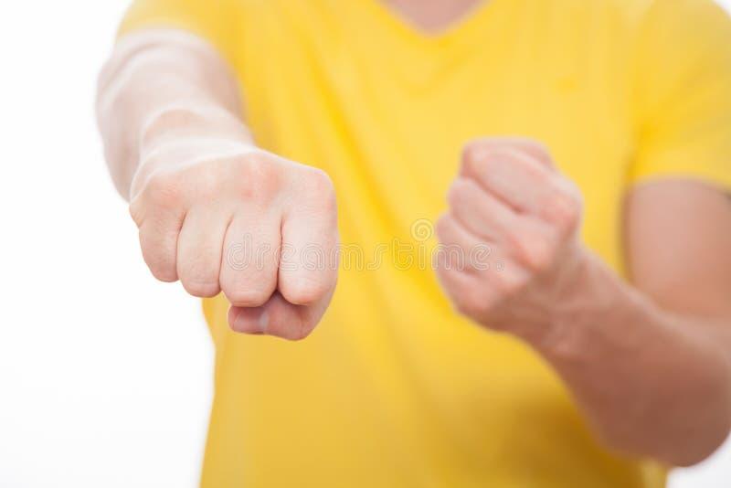 显示他强的拳头的人 库存图片