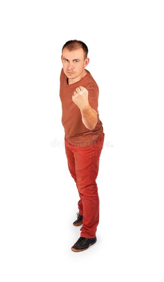显示他的拳头的年轻人 免版税库存图片
