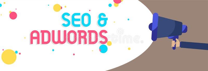 显示Seo和Adwords的文本标志 概念性照片薪水每点击销售谷歌Adsense人的数字式拿着扩音机loudspeak 库存图片