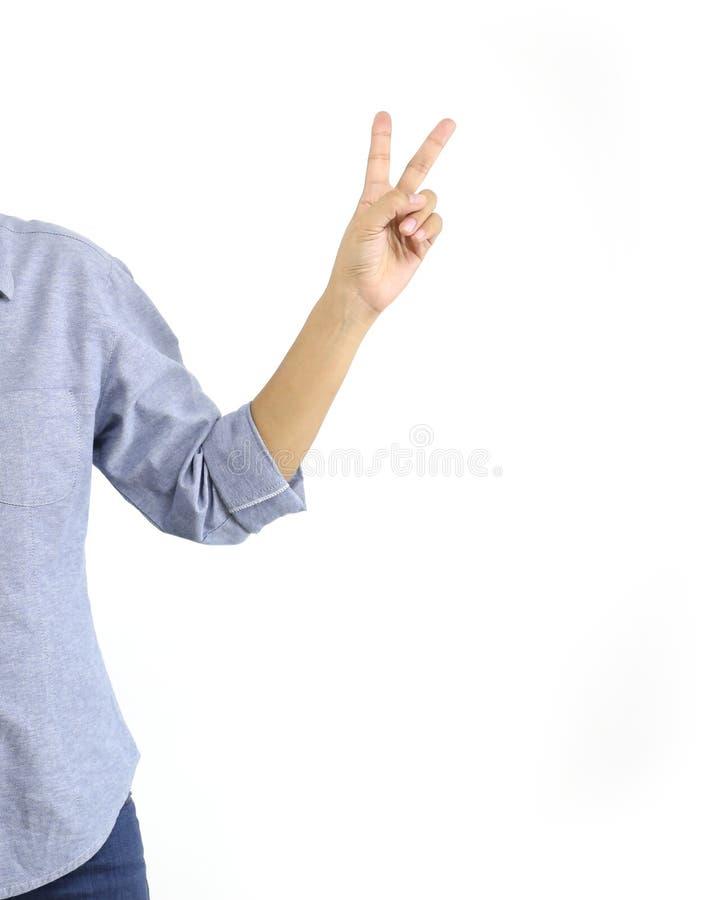 显示v标志胜利或和平与手指手势的妇女 图库摄影