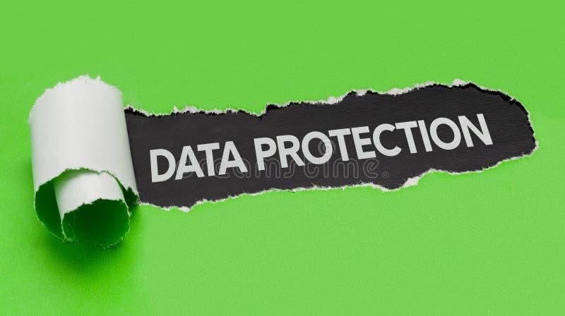 显露词数据保护的被撕毁的纸 库存照片