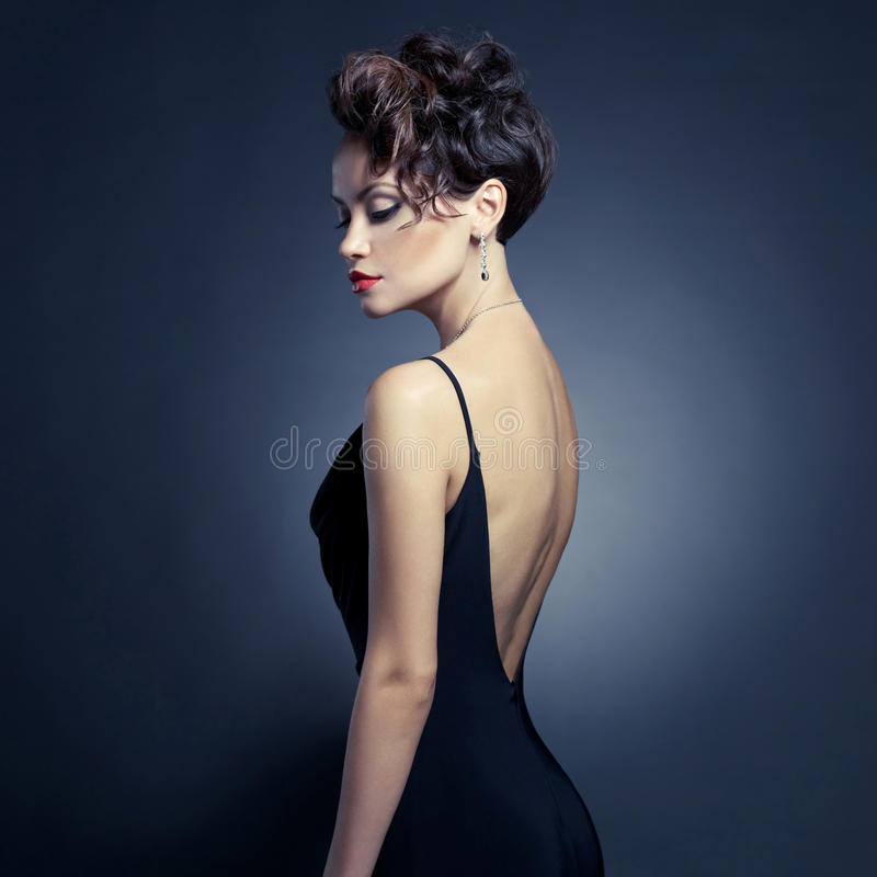晚礼服的典雅的夫人 免版税图库摄影
