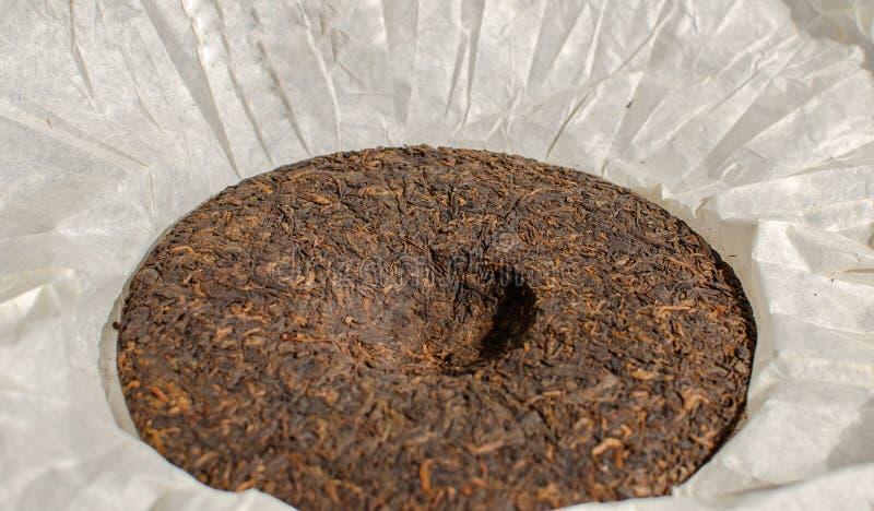 普洱哈尼族彝族自治县或puerh -被按的被发酵的茶 免版税库存图片