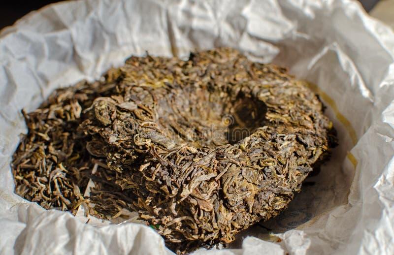 普洱哈尼族彝族自治县或puerh -被按的被发酵的茶 免版税库存照片