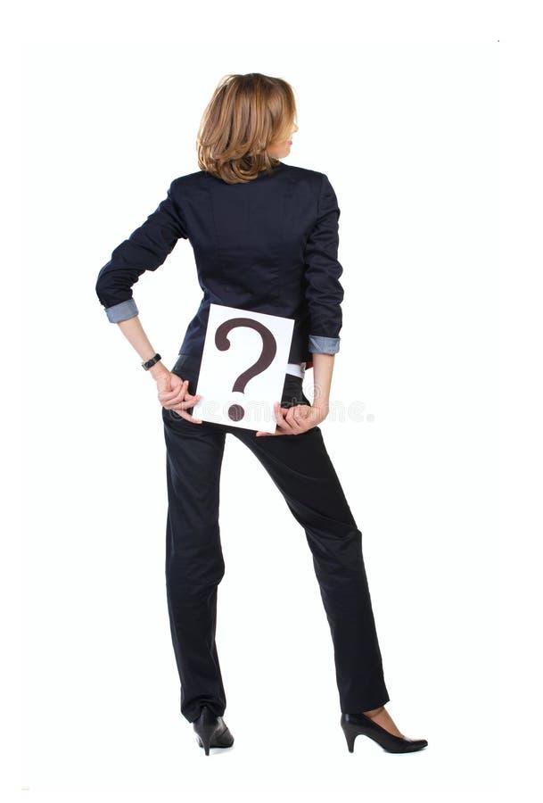 普通西装的女实业家与问号b 库存图片