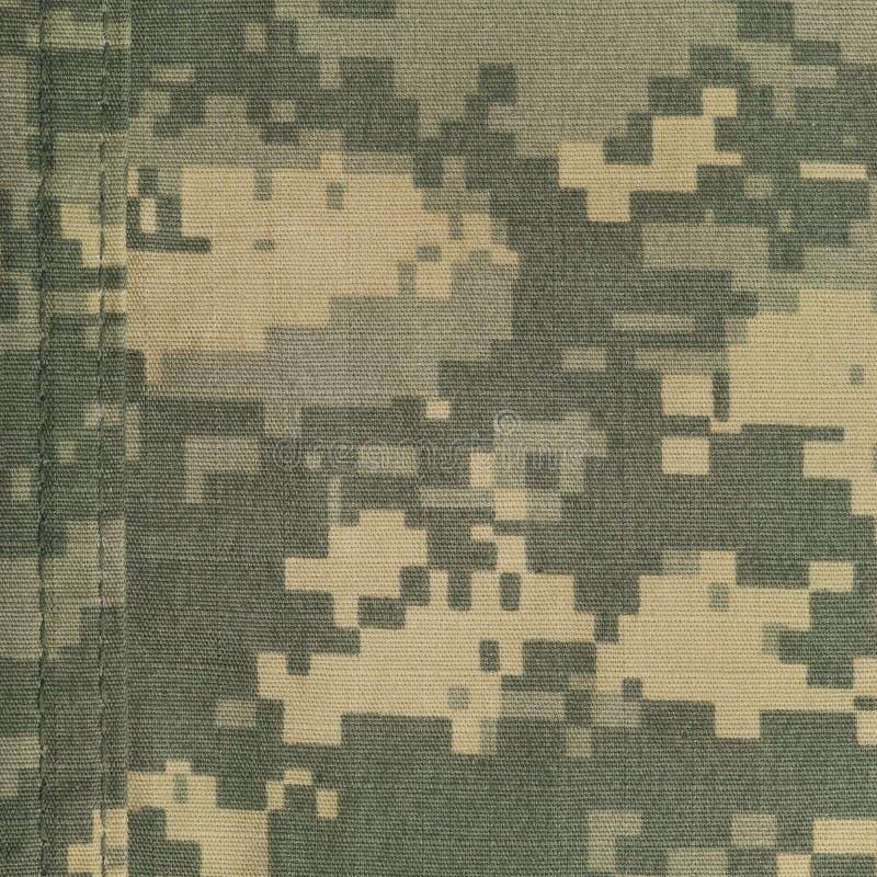 普遍伪装样式,军队作战一致的数字式camo,双重螺纹缝,美国军事ACU宏观特写镜头,裂口中止织品 库存图片