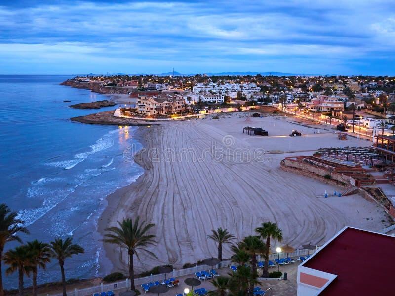 普遍的夏天旅行目的地La Zenia海滩奥里韦拉肋前缘 免版税图库摄影