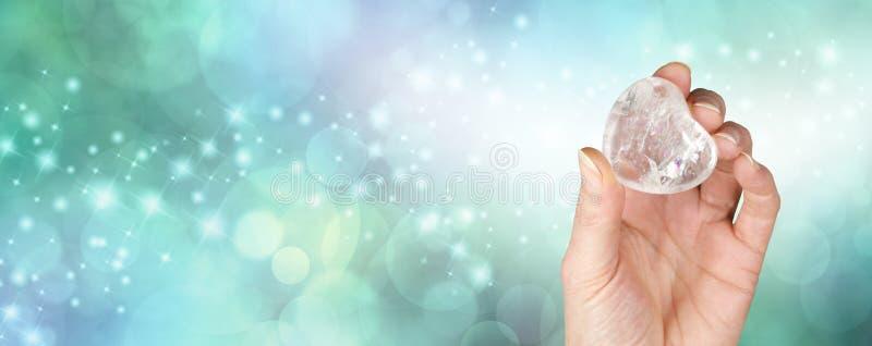 水晶愈合的横幅有bokeh绿色背景 免版税库存图片