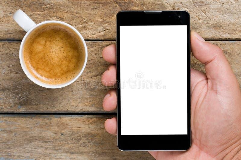 智能手机和咖啡 免版税图库摄影