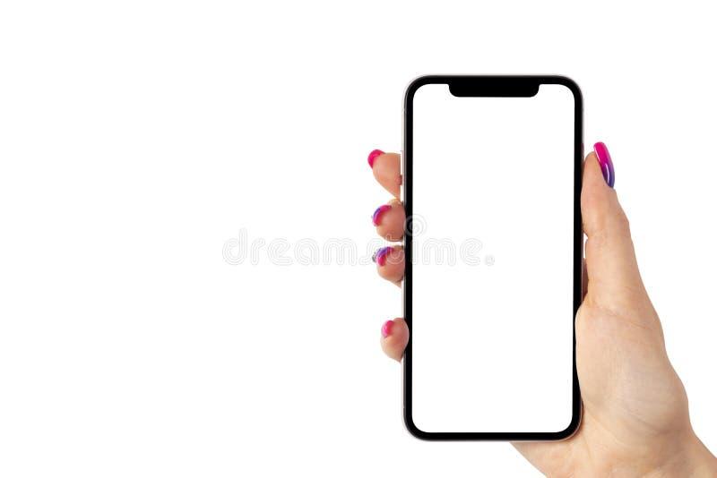 智能手机大模型在妇女手上 与空白的白色屏幕的新的现代黑frameless智能手机大模型 隔绝在白色backgroun 库存照片