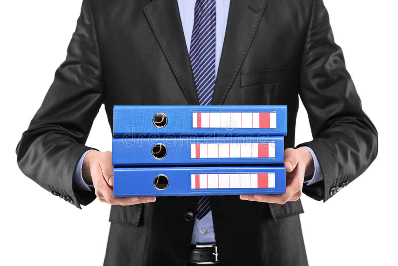 暂挂三的蓝色生意人文件夹 库存图片
