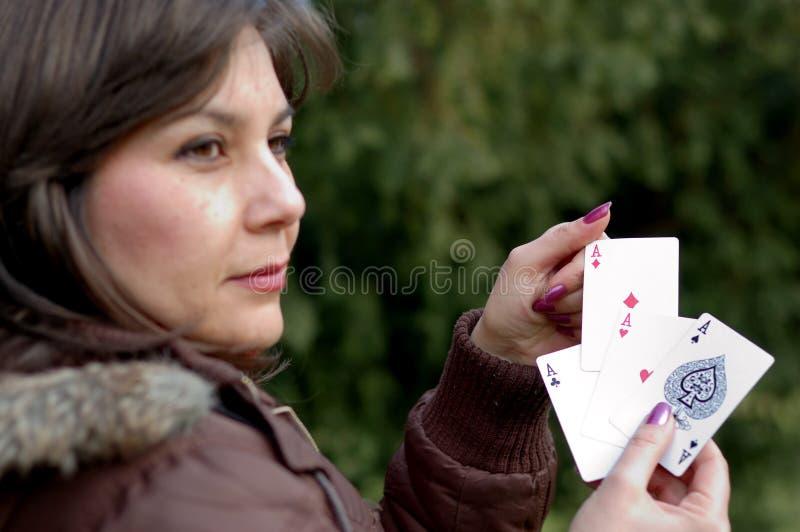 暂挂演奏的看板卡妇女 库存图片