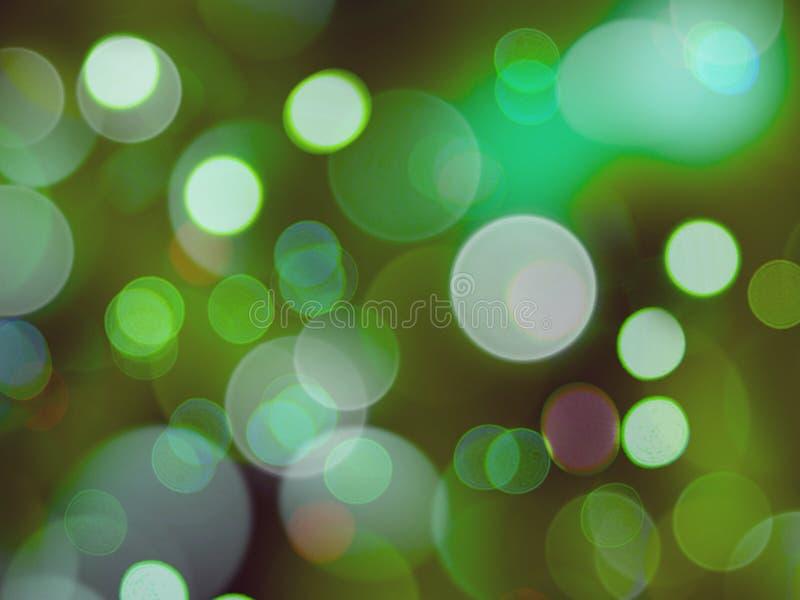 暗夜背景下绿白模糊的圆形发光灯 库存图片