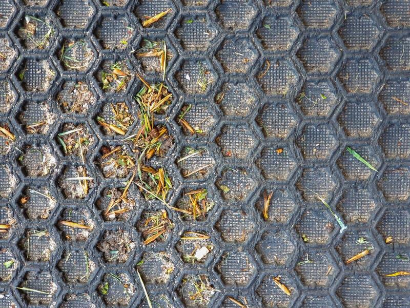 暗淡黑蜂窝样式的地板 免版税图库摄影