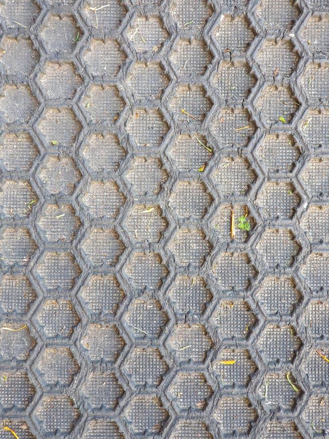 暗淡黑蜂窝样式的地板 库存图片