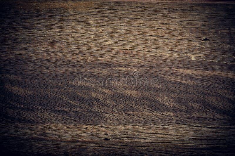 黑暗的木背景,木板概略的五谷表面纹理 图库摄影