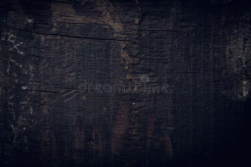 黑黑暗的木背景,木板概略的五谷表面 免版税库存图片