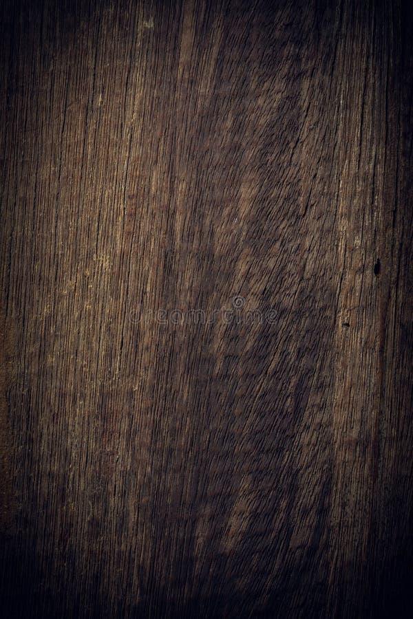 黑暗的木背景,木板概略的五谷表面 库存照片