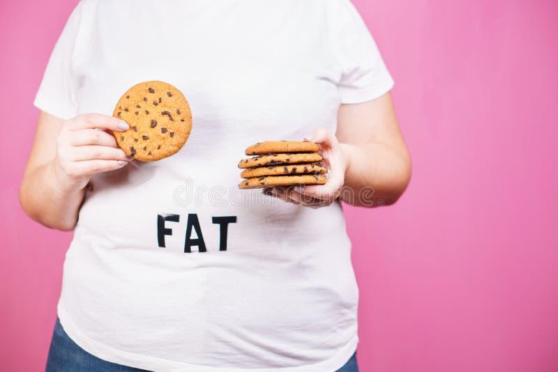 暴饮暴食,节食,暴食者,糖瘾,糖尿病 库存照片