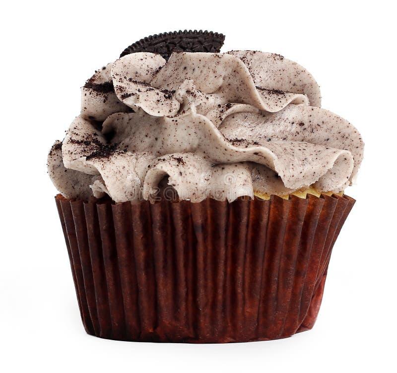 曲奇饼和奶油色杯形蛋糕 免版税库存照片
